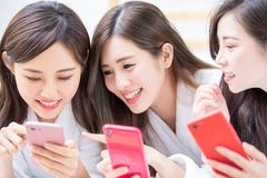 Women share with smartphone. Smiling asian women wearing bathrobe are share something with the smart phone royalty free stock photo