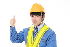 Smiling Asian worker Stock Images