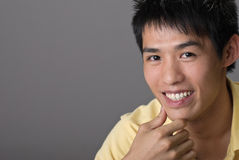Smiling Asian young man Royalty Free Stock Photo