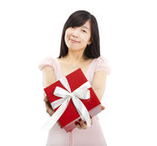 Smiling asian young woman holding gift Stock Photo