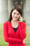 Smiling Asian young woman take a call Stock Photos