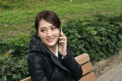 Smiling Asian young woman take a call Royalty Free Stock Photography