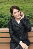 Smiling Asian young woman take a call Stock Images