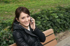 Smiling Asian young woman take a call Royalty Free Stock Photo