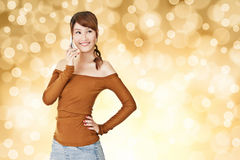 Smiling Asian young woman use cellphone Stock Image