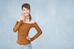 Smiling Asian young woman use cellphone Stock Images