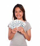 Smiling asiatic young woman with cash money Royalty Free Stock Photography