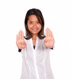 Smiling asiatic young woman giving the high Stock Images