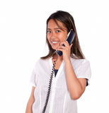 Smiling asiatic young woman speaking on phone Royalty Free Stock Photos