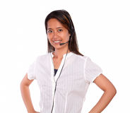 Smiling asiatic young woman using headphones Stock Photo