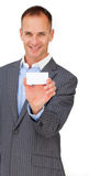 Smiling assertive businessman showing a white card Royalty Free Stock Images