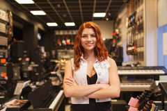 Smiling assistant or customer at music store Royalty Free Stock Photography