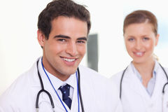 Smiling assistant doctors standing next to each other Royalty Free Stock Photo