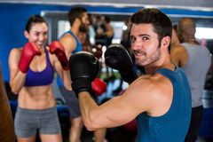 Smiling athlete boxing with woman Stock Photos