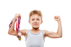 Smiling athlete champion boy gesturing for victory triumph. Sport success and win concept - smiling athlete champion child boy hand holding first place victory Stock Image