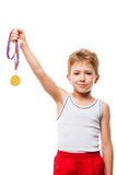 Smiling athlete champion child boy gesturing for victory triumph Stock Images