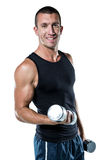 Smiling athlete working out with dumbbells Royalty Free Stock Images