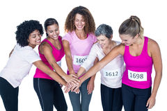 Smiling athletes putting their hands together Stock Image