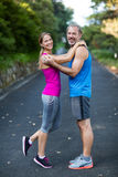 Smiling athletic couple embracing each other stock images