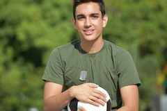 Smiling Athletic Hispanic Male Teen Soldier. A handsome hispanic male teenager stock photography