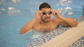 Smiling athletic swimmer at swimming pool stock footage
