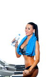 Smiling athletic woman drinking water on a Royalty Free Stock Image