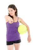 Smiling athletic woman pointing his finger at you. Isolated on white background Royalty Free Stock Photo