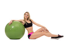 Smiling athletic woman posing with fitness ball Royalty Free Stock Photos