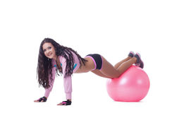 Smiling athletic woman posing with pink sport ball Stock Photography