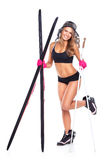 Smiling athletic woman with skis and ski poles in their hands Royalty Free Stock Image