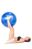 Smiling athletic woman working out with exercise ball Royalty Free Stock Photo