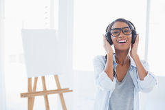 Smiling attractive artist listening to music Royalty Free Stock Image