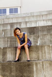 Smiling Attractive Asian American Woman Sitting On Steps Royalty Free Stock Image