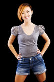 Smiling Attractive Asian American Woman Standing Shorts Stock Photography