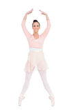 Smiling attractive ballerina standing on her tiptoes Stock Photography