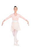 Smiling attractive ballerina standing in a pose Royalty Free Stock Image