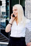 Smiling attractive blonde businesswoman with smartphone Royalty Free Stock Photos