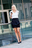 Smiling attractive blonde businesswoman with smartphone Royalty Free Stock Photo
