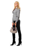 Smiling attractive blonde with a handbag Stock Image
