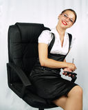 Smiling attractive business woman. Posing on office chair Stock Images