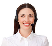 Smiling attractive businesswoman with headset on Royalty Free Stock Photography