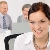 Smiling attractive businesswoman in office closeup Stock Photo