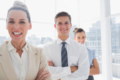 Smiling attractive businesswoman standing with arms crossed Royalty Free Stock Image