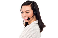 Smiling attractive call center executive Stock Photo