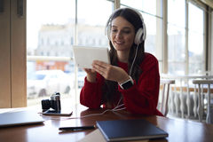Smiling attractive female student music lover listening favorite compositions Royalty Free Stock Photos
