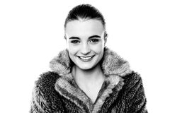 Smiling attractive girl in furry overcoat Royalty Free Stock Photography