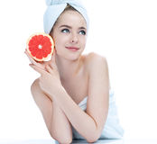 Smiling attractive girl with grapefruit. Royalty Free Stock Image
