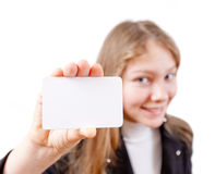 Smiling attractive girl holds plastic card Royalty Free Stock Images