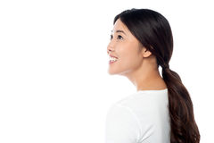Smiling attractive girl looking at something Stock Images