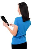 Smiling attractive girl operating touch pad device Stock Photos